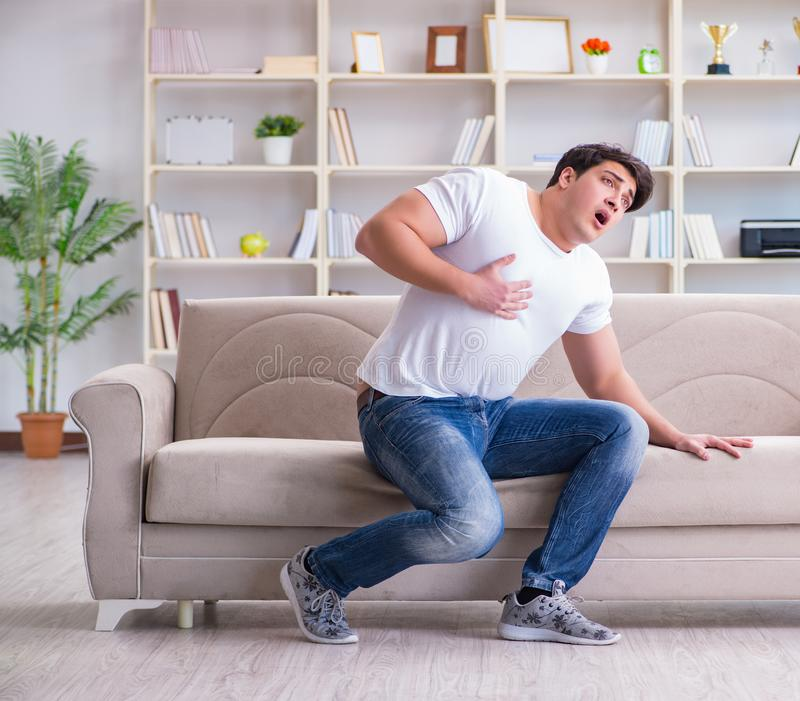 Man suffering from sick stomach and vomiting. The man suffering from sick stomach and vomiting stock image