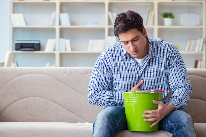 The man suffering from sick stomach and vomiting. Man suffering from sick stomach and vomiting royalty free stock photo