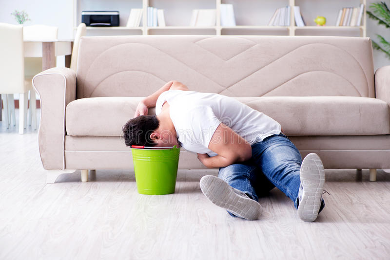 The man suffering from sick stomach and vomiting. Man suffering from sick stomach and vomiting stock photos
