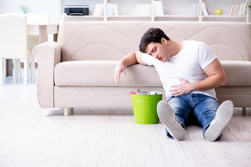 The man suffering from sick stomach and vomiting. Man suffering from sick stomach and vomiting stock image