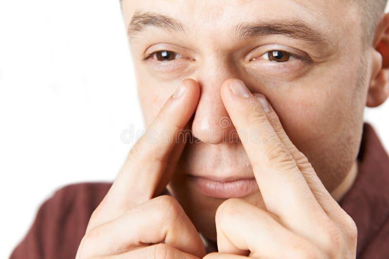 Studio Shot Of Man Suffering With Sinus Problem royalty free stock photos