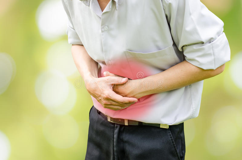 Man suffering from stomach ache because he has diarrhea royalty free stock image