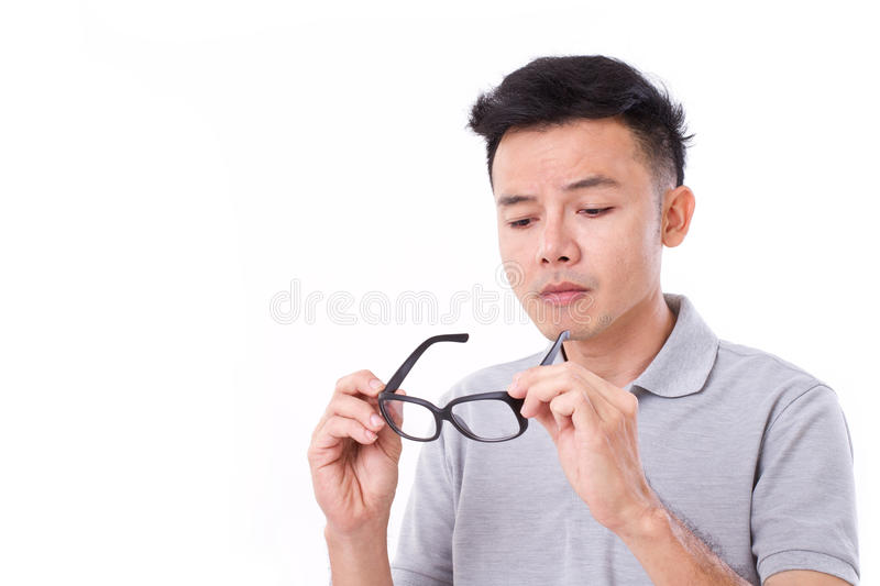 Man suffers from short-sightedness, myopia. Or others eye disorder royalty free stock photo