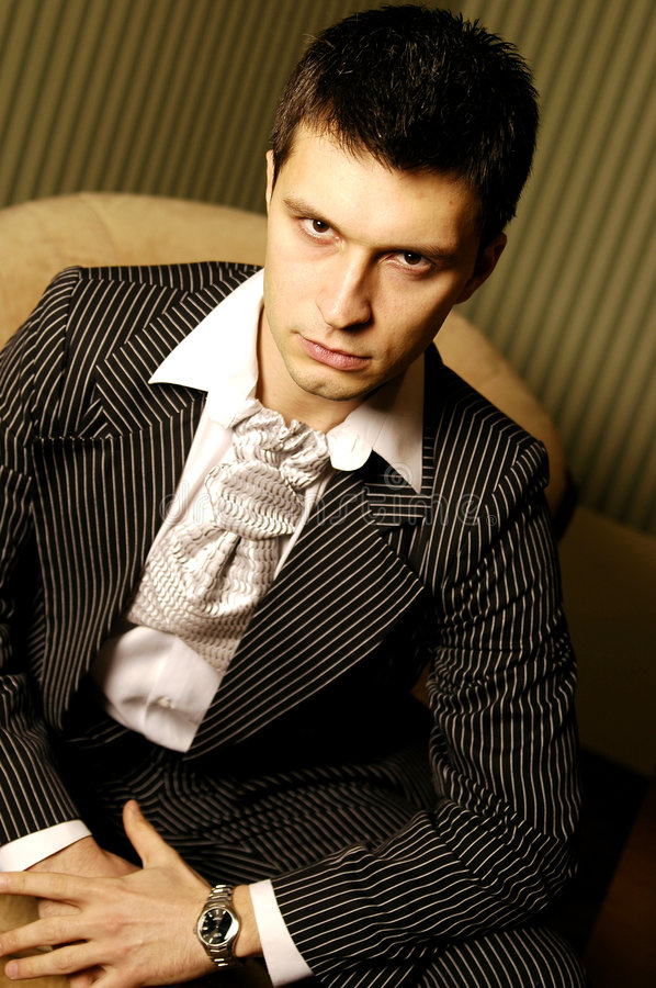 Man in suit. Caucasian man wearing a suit with strips stock photos