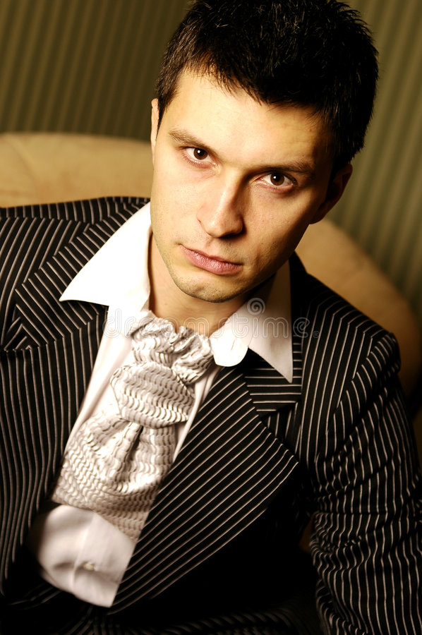 Man in suit. Caucasian man wearing a suit with strips stock photo