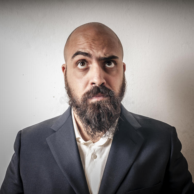 Download Man With A Suit And Beard And Strange Expressions Stock Photo - Image of brown, lifestyle: 26711420