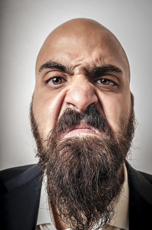 Download Man With A Suit And Beard And Strange Expressions Stock Image - Image: 26711443