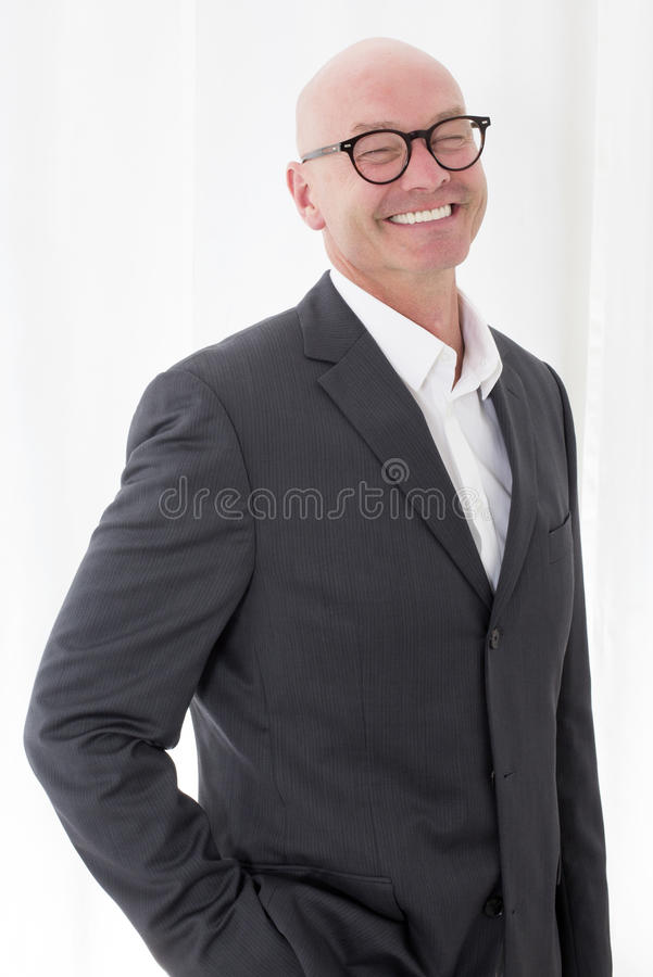 Man in a suit with a big smile royalty free stock image