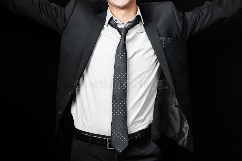 Man in suit on a black background. Studio shot royalty free stock photo