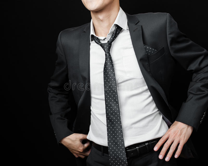 Man in suit on a black background royalty free stock image