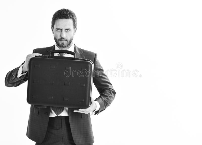 Man in suit or businessman with serious face holds briefcase royalty free stock photography