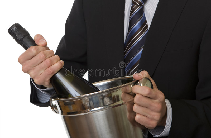 Man with suit champagne bottle in ice-pail. Party on new years eve or anniversary royalty free stock photo