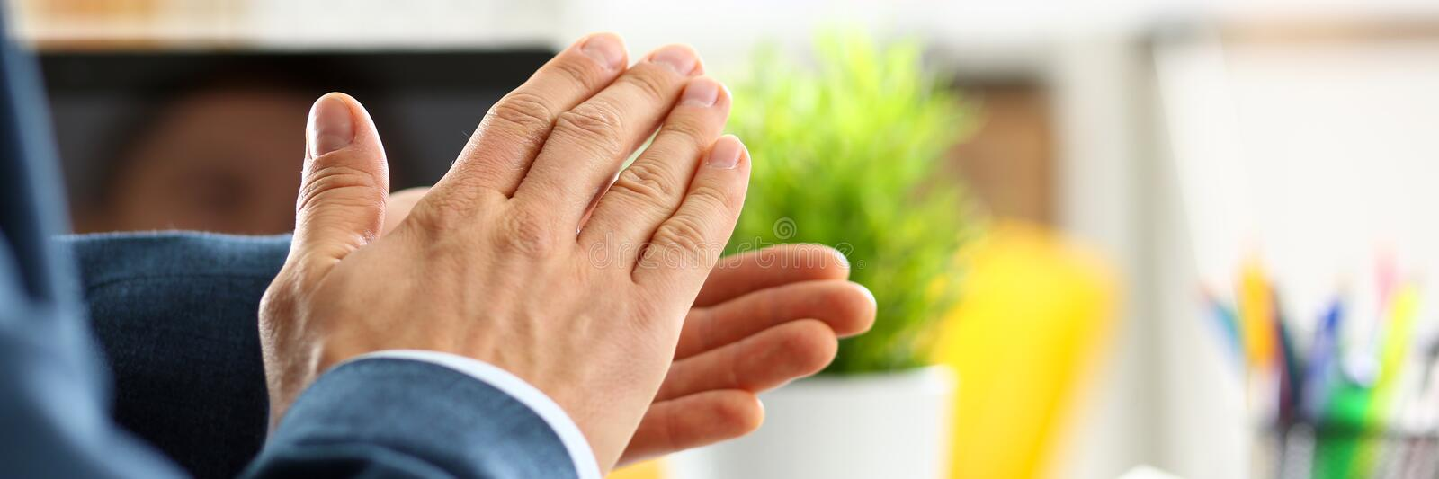 Man in suit clap his arms congrats. For successful seminar in office closeup. Thank symbol great lecture job emotion worker introduce colleague negotiation royalty free stock photos