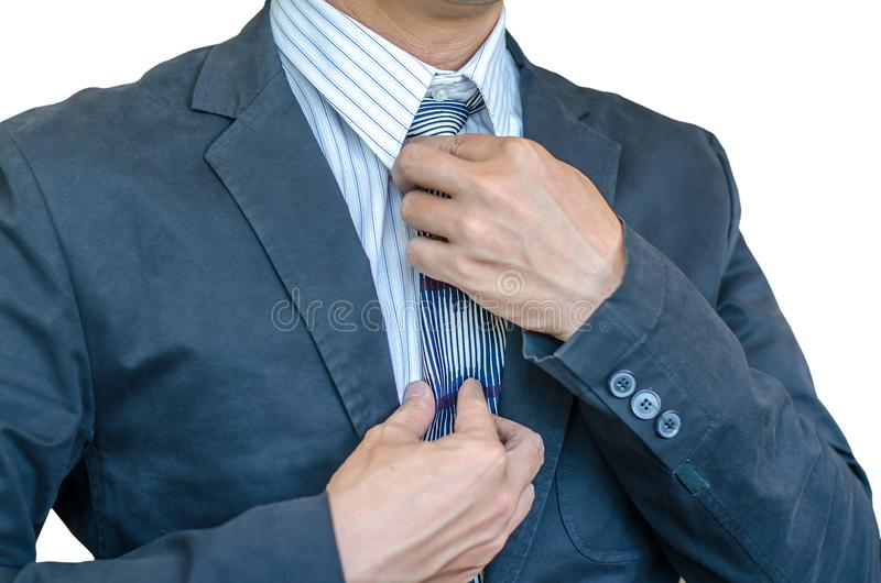 Man in a suit fixing his tie. royalty free stock photos