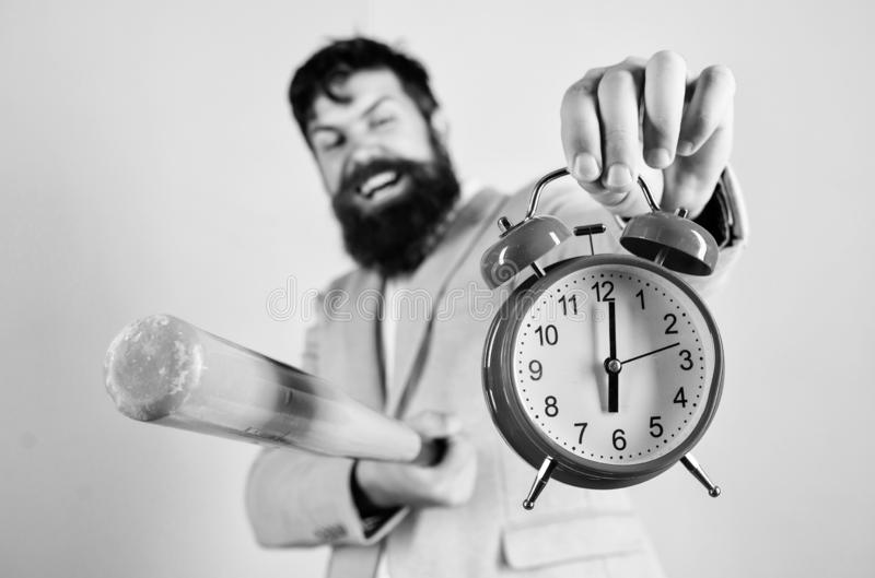 Man suit hold clock and baseball bat in hands. Business discipline concept. Time management and discipline. Discipline royalty free stock photos