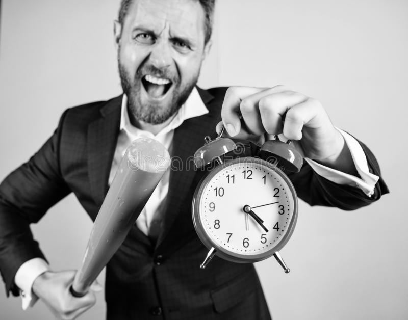 Man suit hold clock in hand and arguing for being late. Business discipline concept. Time management and discipline stock images