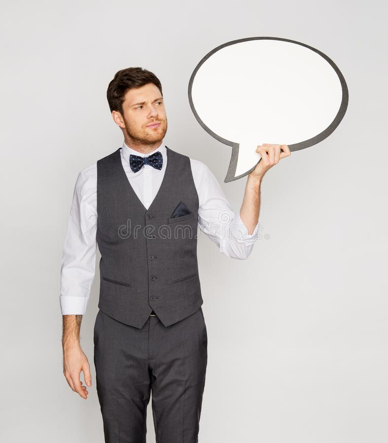 Man in suit holding blank text bubble banner royalty free stock photography