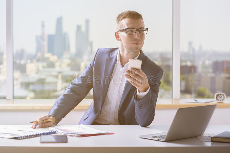 Man in suit holding cellphone royalty free stock photo