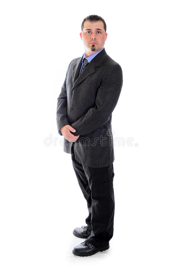 Man in suit holding his hands. A man in a dark grey suit holding his hands stock photos