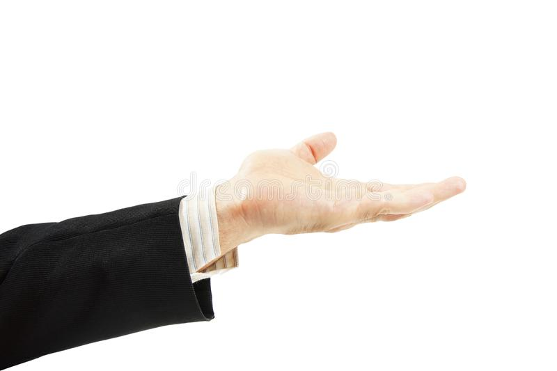 Man in a suit holds his hand with an open palm up isolated on white. Background royalty free stock images