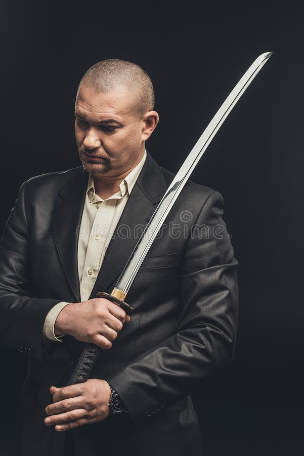 man in suit with katana sword royalty free stock photography