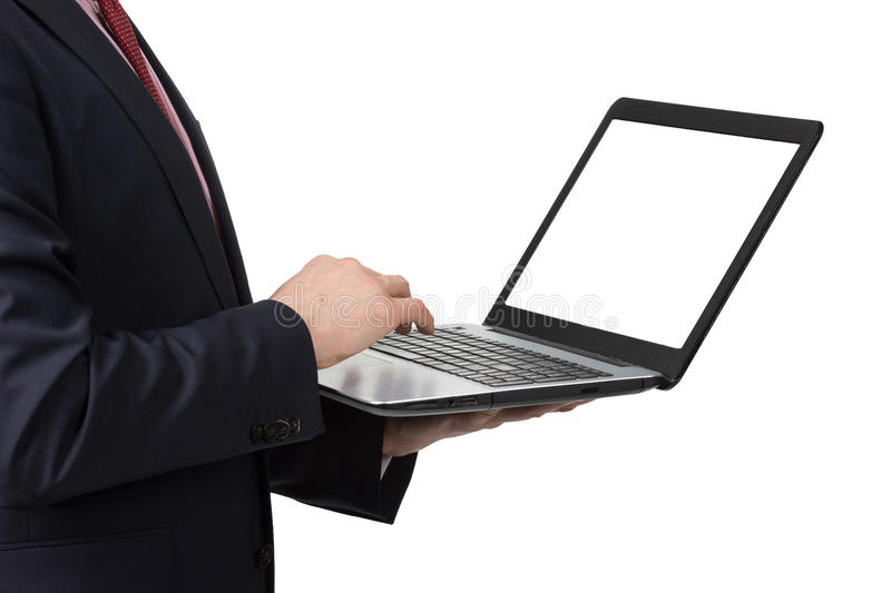 Man in suit with laptop. Standing on white background stock photography
