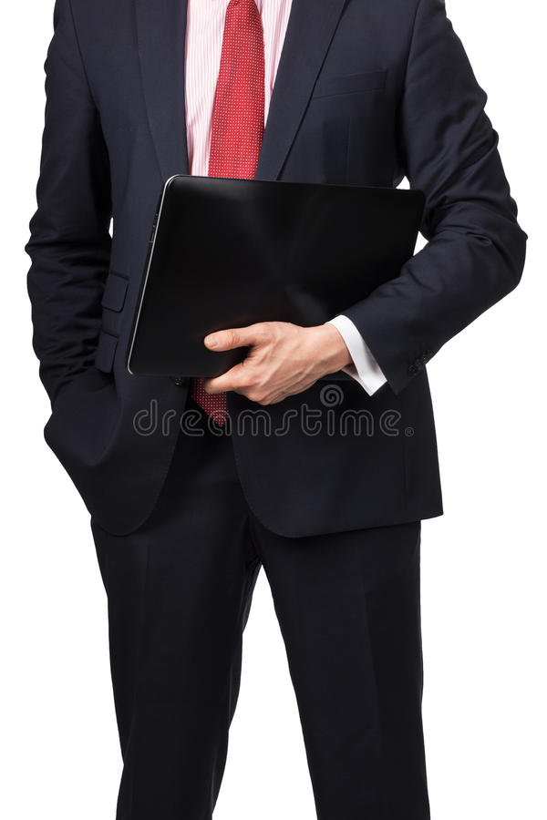 Man in suit with laptop. Standing on white background royalty free stock photography