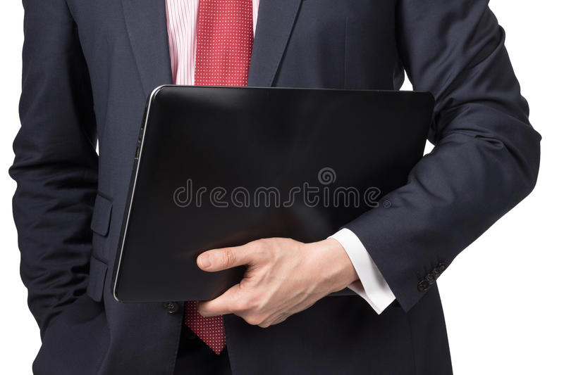 Man in suit with laptop. Standing on white background stock images