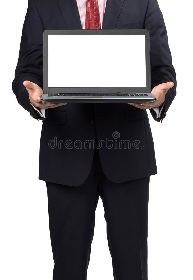 Man in suit with laptop. Standing on white background stock photo