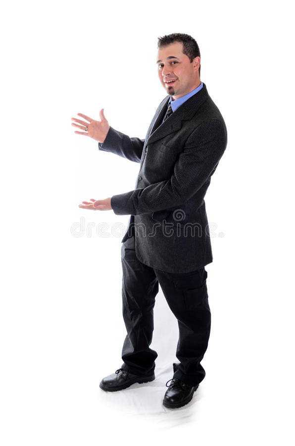 Man in suit presenting product. Man in suit presenting his hands to the left stock photos