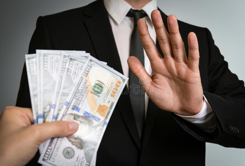 Man in a suit refuses to take bribe money. Business, Corruption, law and public administration concept royalty free stock image