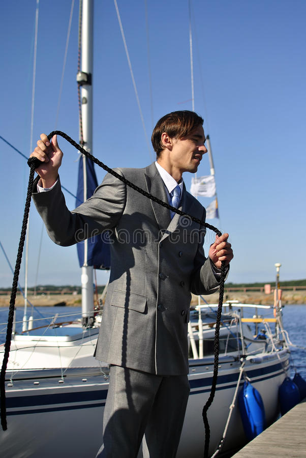 Download Man In A Suit With A Rope In His Hands Royalty Free Stock Images - Image: 20645829