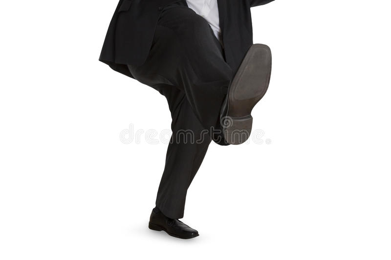 Man in suit slipping on wet floor royalty free stock image