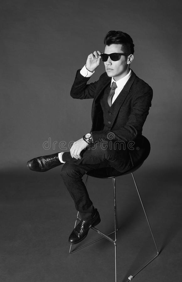 Man with suit and sunglasses stock photo