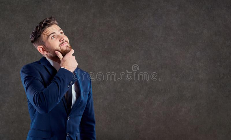 A man in a suit is thinking over a question. royalty free stock photos