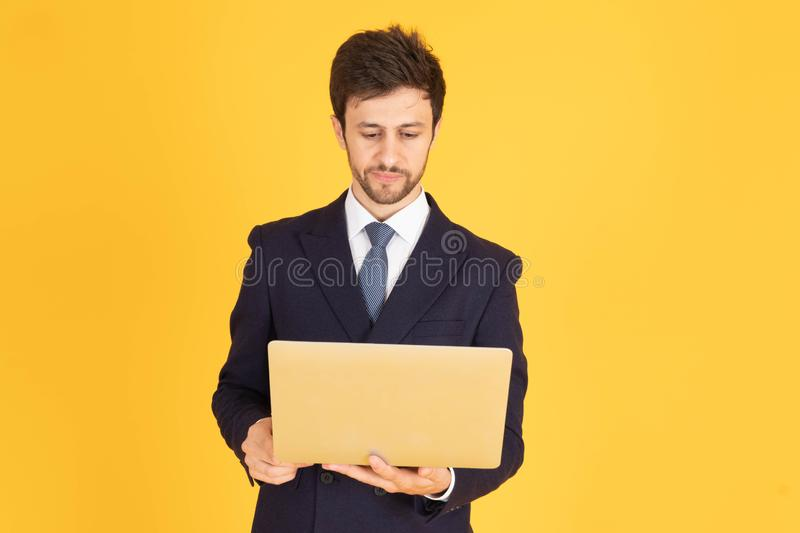A man in a suit with a tie Handsome looking face with beard In the businessman look Holding a notebook To work Or communicating stock image
