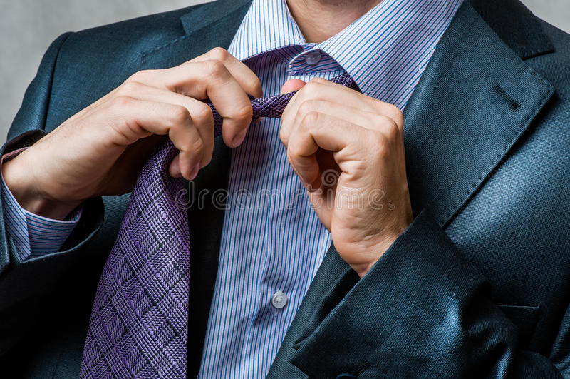 Man in suit untying his neck tie. Business man in suit untying his neck tie stock photos