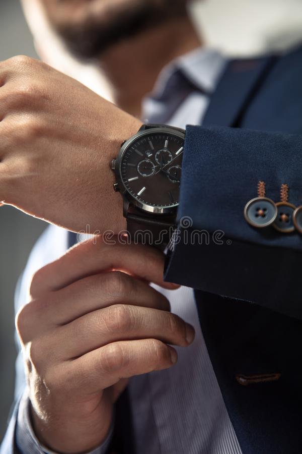 Man with suit and watch royalty free stock photography