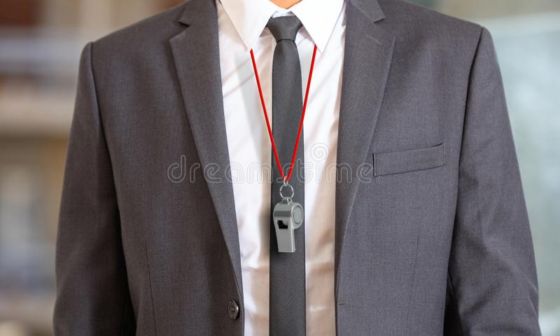 Man in suit wearing a whistle with red string. 3d illustration. Sports business. Man in suit wearing a whistle with red string. 3d illustration royalty free illustration
