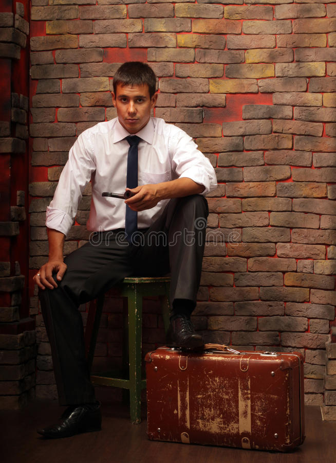 A Man And A Suitcase Royalty Free Stock Photos