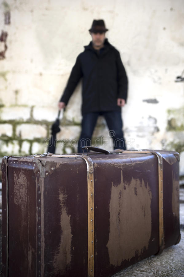 Man and suitcase royalty free stock photo