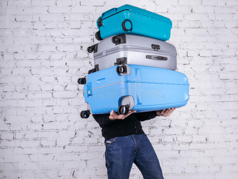 The man with the suitcases stock photography