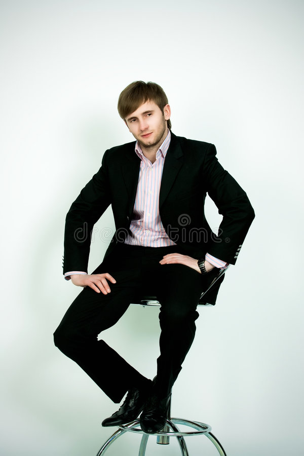 Download Man In Suite Sitting On Chair Stock Photo - Image: 8848486