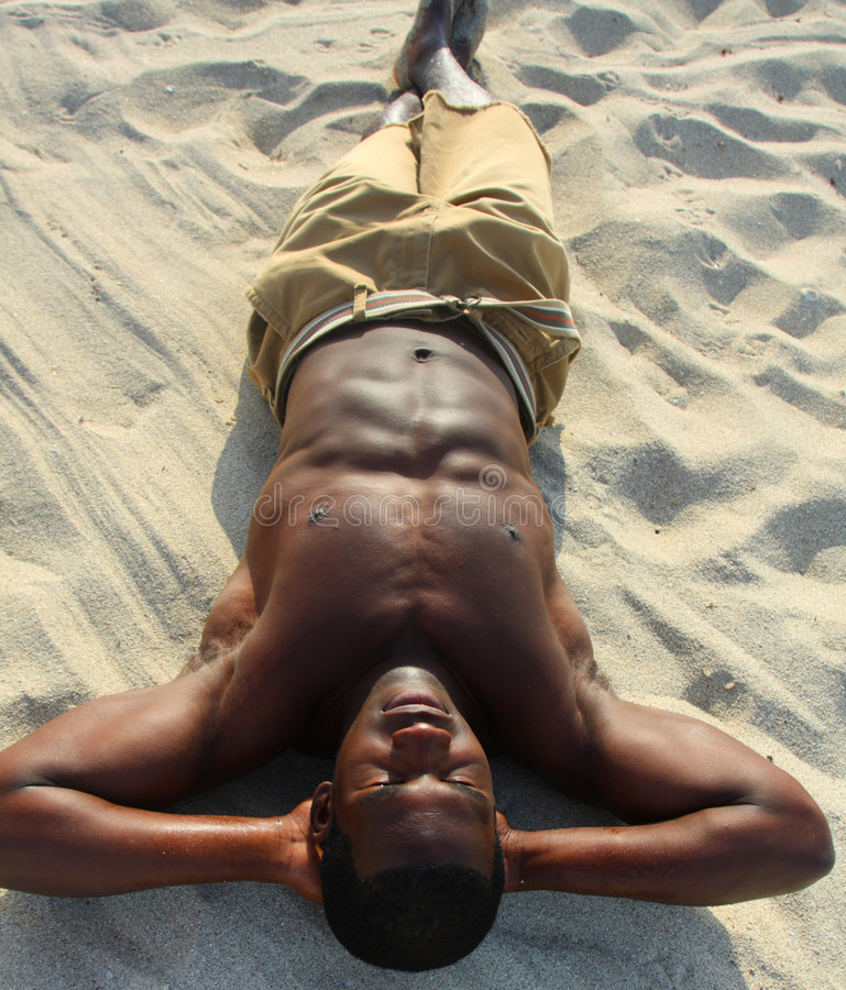 Download Man Sunbathing On The Beach Stock Photo - Image: 4677842