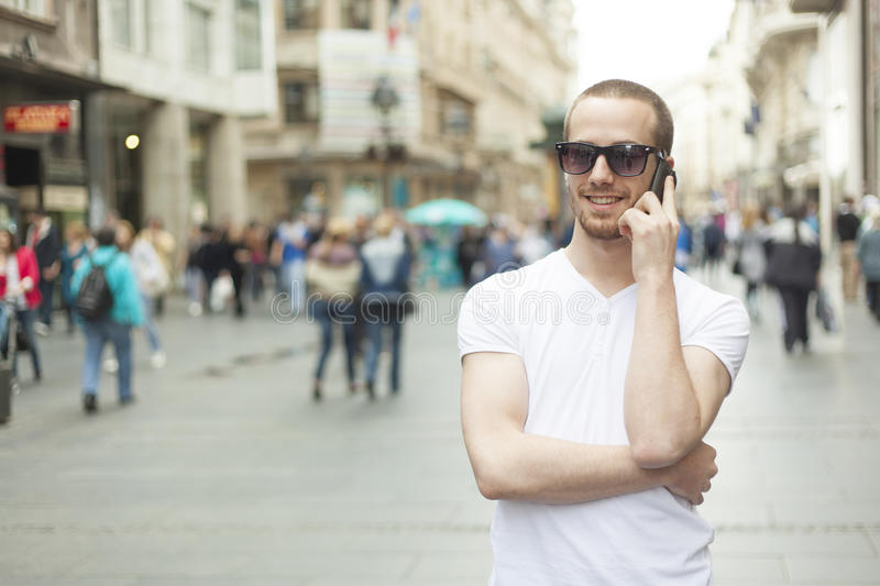 Download Man With Sunglasses And Cell Phone Walking Stock Photo - Image: 25504472