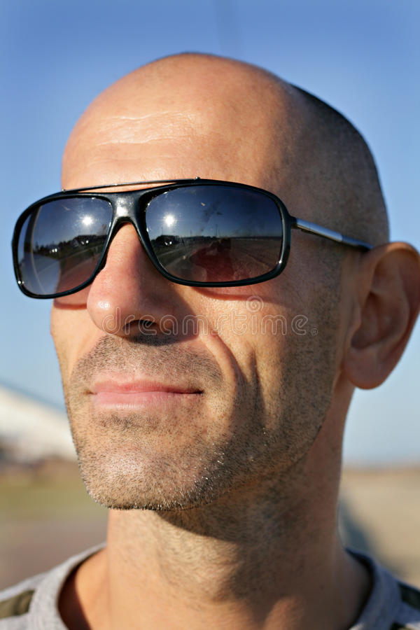 Man with sunglasses enjoying the outdoor life royalty free stock image