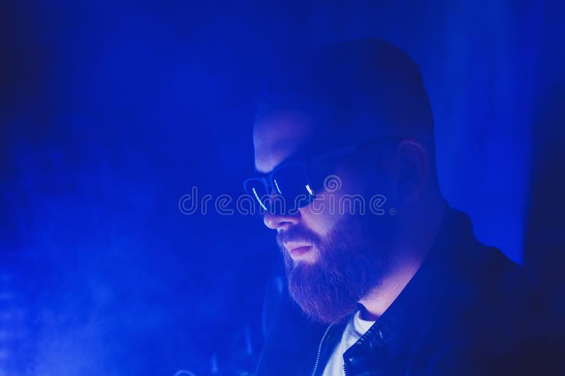 Man in sunglasses smokes stock images