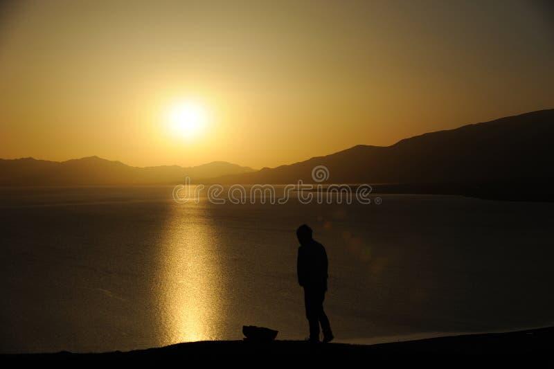 Man at sunrise stock images
