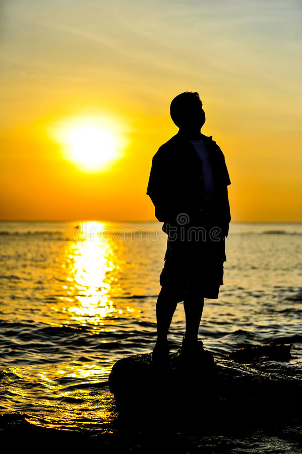 Man in sunset stock image