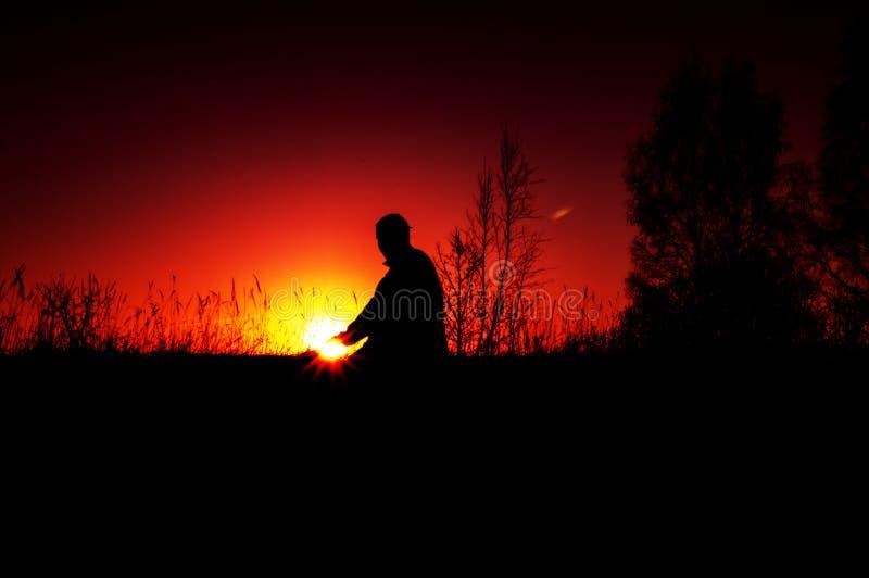 Man at sunset royalty free stock image